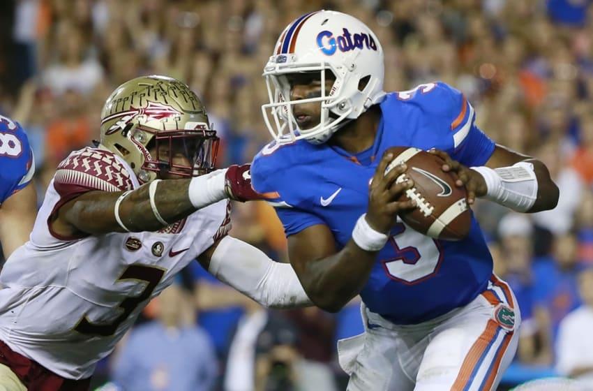 Nov 28, 2015; Gainesville, FL, USA; Florida Gators quarterback Treon Harris (3) runs as Florida State Seminoles defensive back Derwin James (3) pressures during the second quarter at Ben Hill Griffin Stadium. Mandatory Credit: Kim Klement-USA TODAY Sports