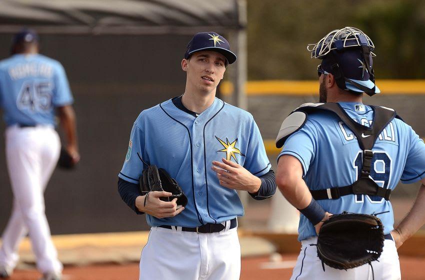 Feb 21, 2016; Port Charlotte, FL, USA; Tampa Bay Rays catcher Curt Casali (19) talks to Rays pitcher Blake Snell (50) at Charlotte Sports Park. Mandatory Credit: Jonathan Dyer-USA TODAY Sports