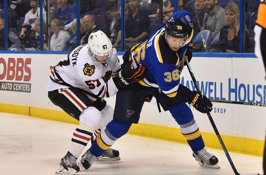Apr 13, 2016; St. Louis, MO, USA; St. Louis Blues right wing Troy Brouwer (36) and Chicago Blackhawks defenseman Trevor van Riemsdyk (57) battle for the puck during the second period in game one of the first round of the 2016 Stanley Cup Playoffs at Scottrade Center. Mandatory Credit: Jasen Vinlove-USA TODAY Sports
