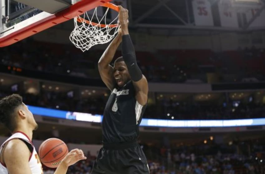 Mar 17, 2016; Raleigh, NC, USA; Providence Friars forward Ben Bentil (0) dunks the ball in front of USC Trojans forward Bennie Boatwright (25) during the first half at PNC Arena. Mandatory Credit: Geoff Burke-USA TODAY Sports