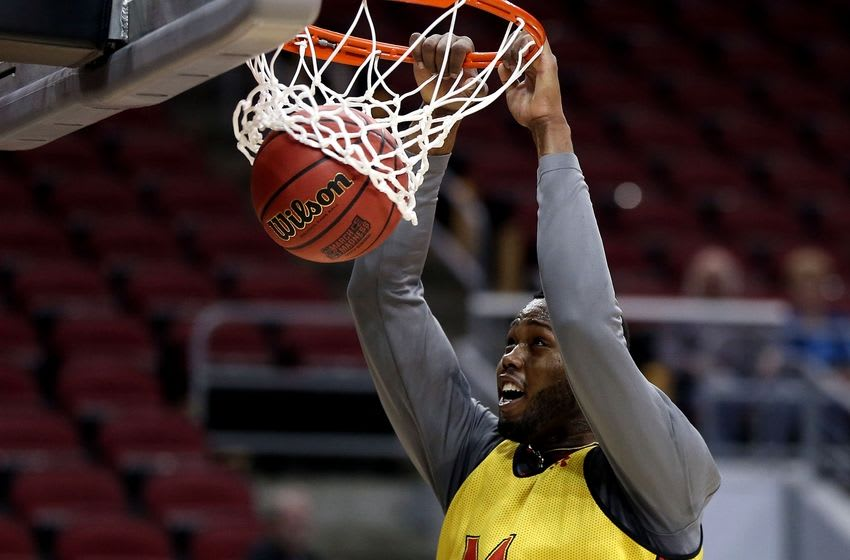 Mar 23, 2016; Louisville, KY, USA; Maryland Terrapins forward Robert Carter (4) dunks the ball during practice the day before the semifinals of the South regional of the NCAA Tournament at KFC YUM!. Mandatory Credit: Peter Casey-USA TODAY Sports