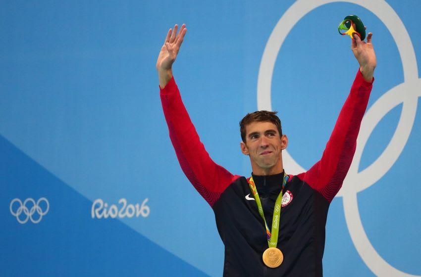 Aug 9, 2016; Rio de Janeiro, Brazil; Michael Phelps (USA) celebrates on the podium after the men