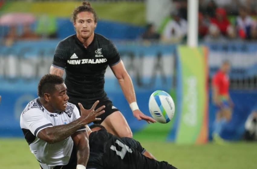 Fiji back Josua Tuisova passes the ball as he is tackled by New Zealand forward DJ Forbes during a rugby sevens match between New Zealand and Fiji. Mandatory Credit: Dan Powers-USA TODAY Sports