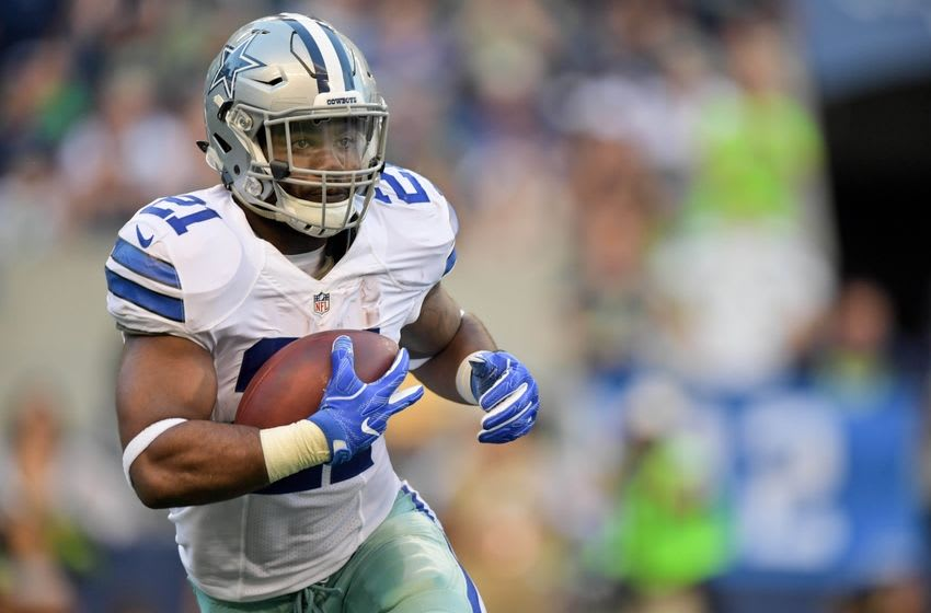 Aug 25, 2016; Seattle, WA, USA; Dallas Cowboys running back Ezekiel Elliott (21) rushes against the Seattle Seahawks during the first half of an NFL football game at CenturyLink Field. Mandatory Credit: Kirby Lee-USA TODAY Sports