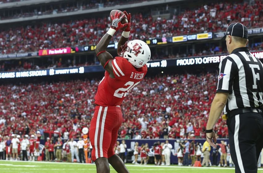 Sep 3, 2016; Houston, TX, USA; Houston Cougars cornerback Howard Wilson (6) catches a missed field goal attempt and returns it for a touchdown during the third quarter against the Oklahoma Sooners at NRG Stadium. Mandatory Credit: Troy Taormina-USA TODAY Sports