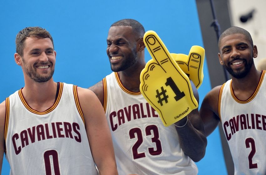 Sep 26, 2016; Cleveland, OH, USA; Cleveland Cavaliers forward Kevin Love (0), forward LeBron James (23) and guard Kyrie Irving (2) laugh during a photo session during media day at Cleveland Clinic Courts. Mandatory Credit: Ken Blaze-USA TODAY Sports