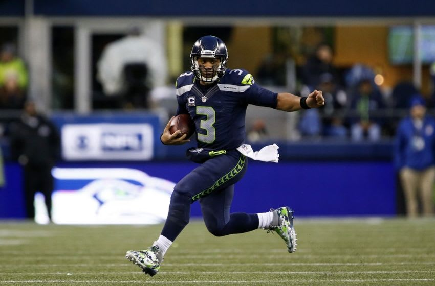 Nov 20, 2016; Seattle, WA, USA; Seattle Seahawks quarterback Russell Wilson (3) rushes against the Philadelphia Eagles during the fourth quarter at CenturyLink Field. Seattle defeated Philadelphia, 26-15. Mandatory Credit: Joe Nicholson-USA TODAY Sports