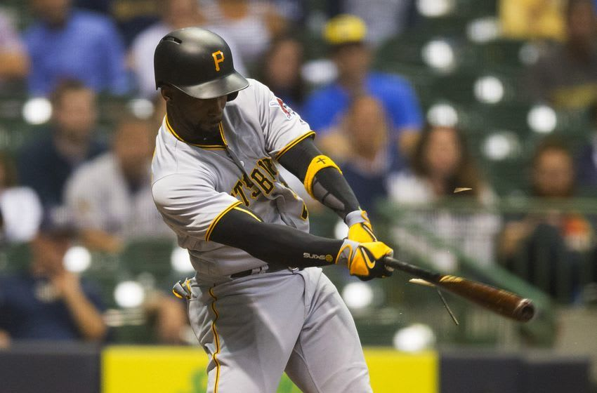 Sep 21, 2016; Milwaukee, WI, USA; Pittsburgh Pirates centerfielder Andrew McCutchen (22) singles during the seventh inning against the Milwaukee Brewers at Miller Park. Mandatory Credit: Jeff Hanisch-USA TODAY Sports