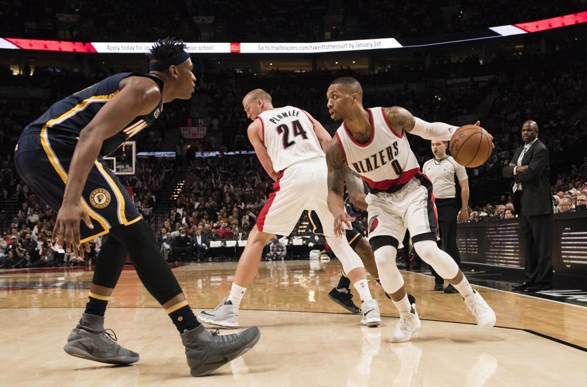 Nov 30, 2016; Portland, OR, USA; Portland Trail Blazers guard Damian Lillard (0) is guarded by Indiana Pacers center Myles Turner (33) during the fourth quarter at Moda Center at the Rose Quarter. The Trail Blazers won 131- 109. Mandatory Credit: Troy Wayrynen-USA TODAY Sports