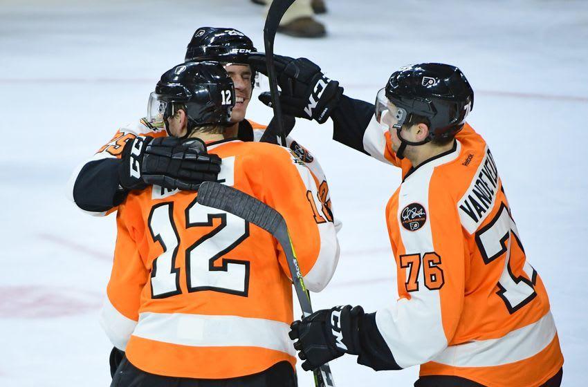 Dec 8, 2016; Philadelphia, PA, USA; Philadelphia Flyers left wing Michael Raffl (12) celebrates with center Nick Cousins (25) and center Chris VandeVelde (76) after defeating the Edmonton Oilers 6-5 at Wells Fargo Center. Mandatory Credit: Eric Hartline-USA TODAY Sports