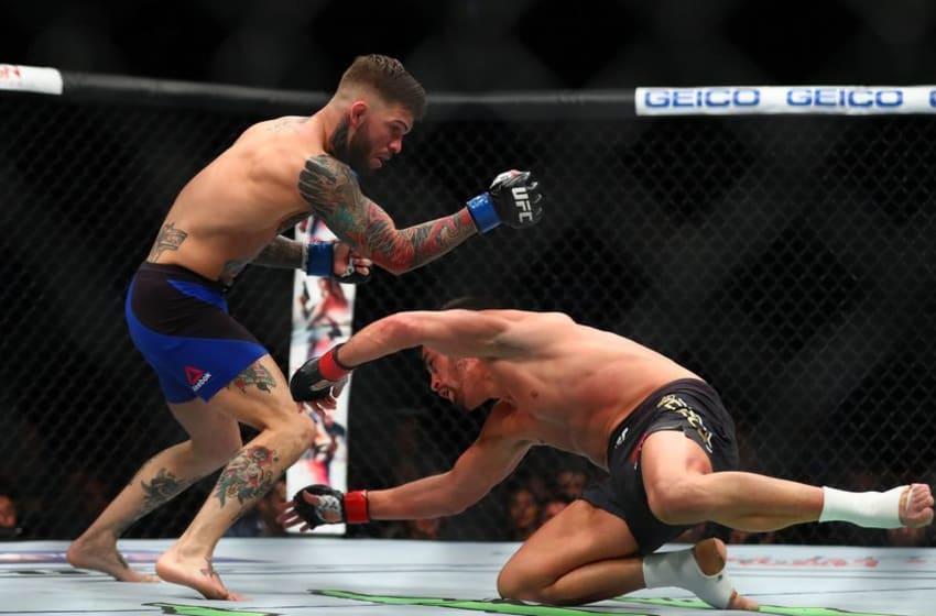 December 30, 2016; Las Vegas, NV, USA; Dominick Cruz slips as Cody Garbrandt moves in on him during UFC 207 at T-Mobile Arena. Mandatory Credit: Mark J. Rebilas-USA TODAY Sports