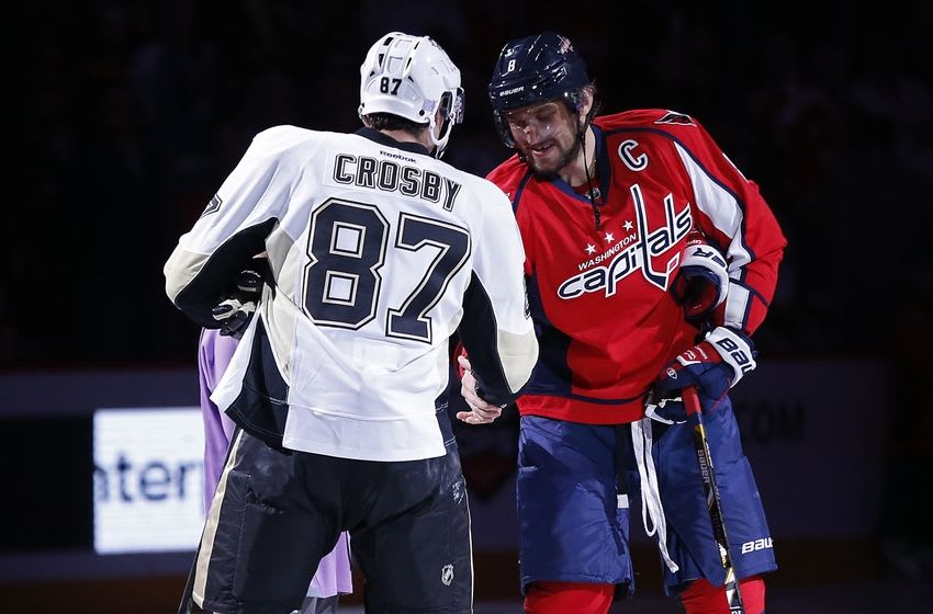 Oct 28, 2015; Washington, DC, USA; Washington Capitals left wing Alex Ovechkin (8) shakes hands with Pittsburgh Penguins center Sidney Crosby (87) during a ceremonial puck drop prior to their game at Verizon Center. The Penguins won 3-1. Mandatory Credit: Geoff Burke-USA TODAY Sports