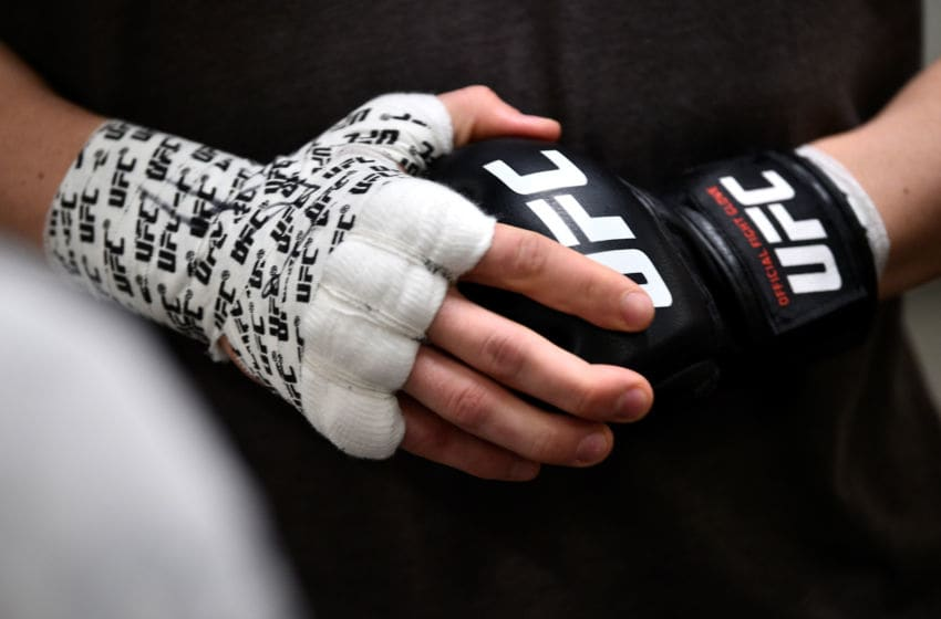 LAS VEGAS, NEVADA - MARCH 02: Edmen Shahbazyan puts on his gloves backstage during the UFC 235 event at T-Mobile Arena on March 2, 2019 in Las Vegas, Nevada. (Photo by Chris Unger/Zuffa LLC/Zuffa LLC via Getty Images)
