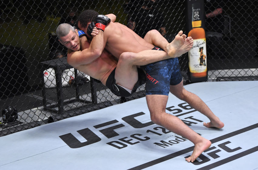 LAS VEGAS, NEVADA - DECEMBER 05: (R-L) Jordan Leavitt slams Matt Wiman in a lightweight bout during the UFC Fight Night event at UFC APEX on December 05, 2020 in Las Vegas, Nevada. (Photo by Chris Unger/Zuffa LLC)