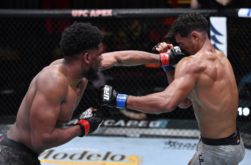 LAS VEGAS, NEVADA - MARCH 06: (L-R) Kennedy Nzechukwu of Nigeria punches Carlos Ulberg of New Zealand in their light heavyweight fight during the UFC 259 event at UFC APEX on March 06, 2021 in Las Vegas, Nevada. (Photo by Jeff Bottari/Zuffa LLC)