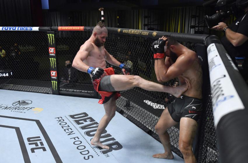 LAS VEGAS, NEVADA - MAY 01: (L-R) Jiri Prochazka of the Czech Republic kicks Dominick Reyes in a light heavyweight bout during the UFC Fight Night event at UFC APEX on May 01, 2021 in Las Vegas, Nevada. (Photo by Jeff Bottari/Zuffa LLC)