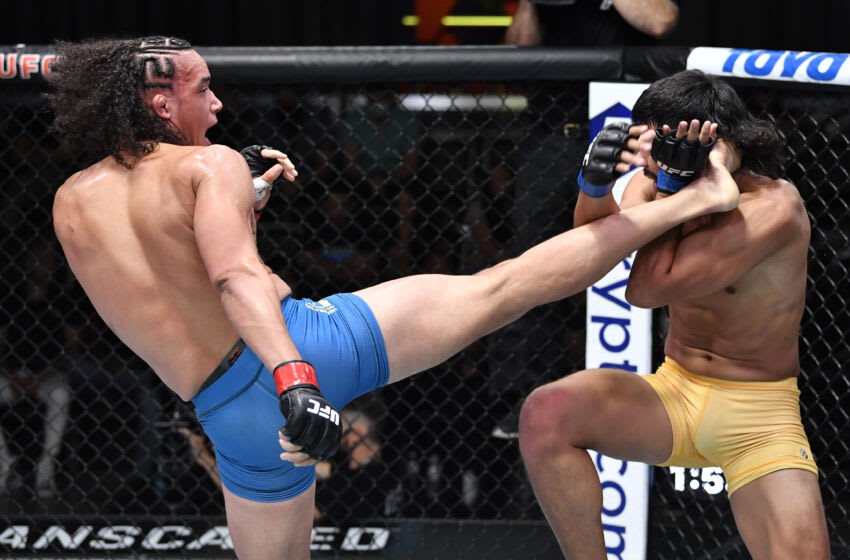 LAS VEGAS, NEVADA - AUG 28: (LR) Bryan Battle kicks Gilbert Urbina in a middleweight fight during the UFC Fight Night event at UFC APEX on August 28, 2021 in Las Vegas, Nevada. (Photo by Chris Unger / Zuffa LLC)