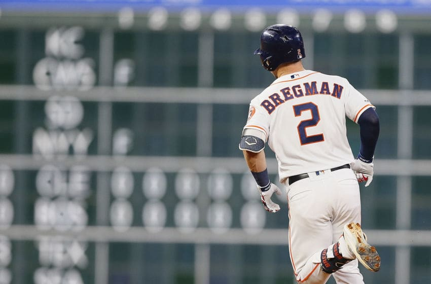 HOUSTON, TEXAS - MAY 28: Alex Bregman #2 of the Houston Astros hits a home run in the sixth inning against the Chicago Cubs at Minute Maid Park on May 28, 2019 in Houston, Texas. (Photo by Bob Levey/Getty Images)