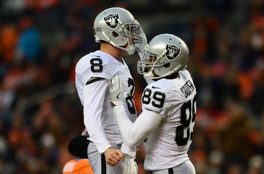DENVER, CO - JANUARY 1: Wide receiver Amari Cooper #89 of the Oakland Raiders celebrates his touchdown with quarterback Connor Cook #8 in the third quarter of the game against the Denver Broncos at Sports Authority Field at Mile High on January 1, 2017 in Denver, Colorado. (Photo by Dustin Bradford/Getty Images)