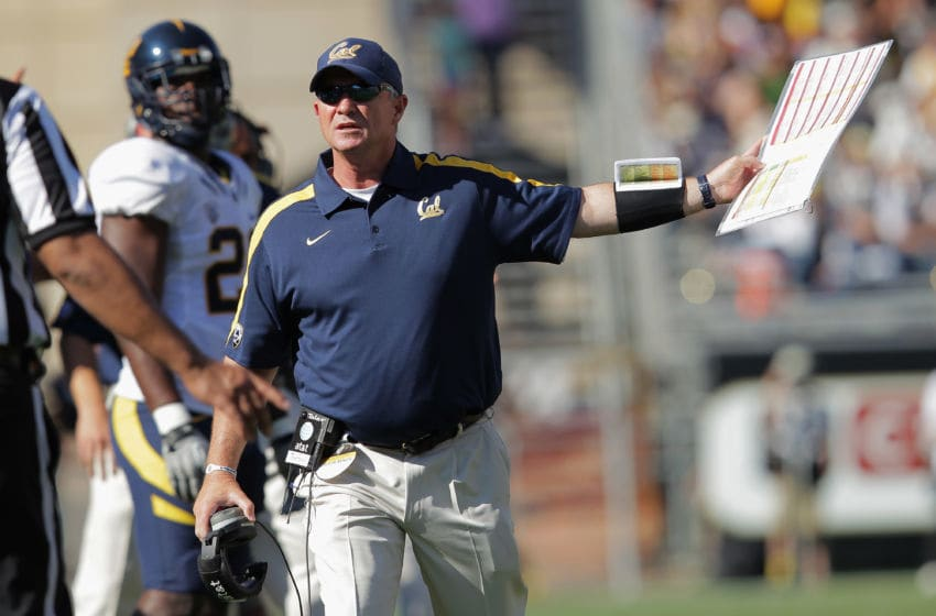 BOULDER, CO - SEPTEMBER 10: Head coach Jeff Tedford of the California Golden Bears contests a call with the officials against the Colorado Buffaloes at Folsom Field on September 10, 2011 in Boulder, Colorado. The Bears defeated the Buffaloes 36-33 in overime. (Photo by Doug Pensinger/Getty Images)