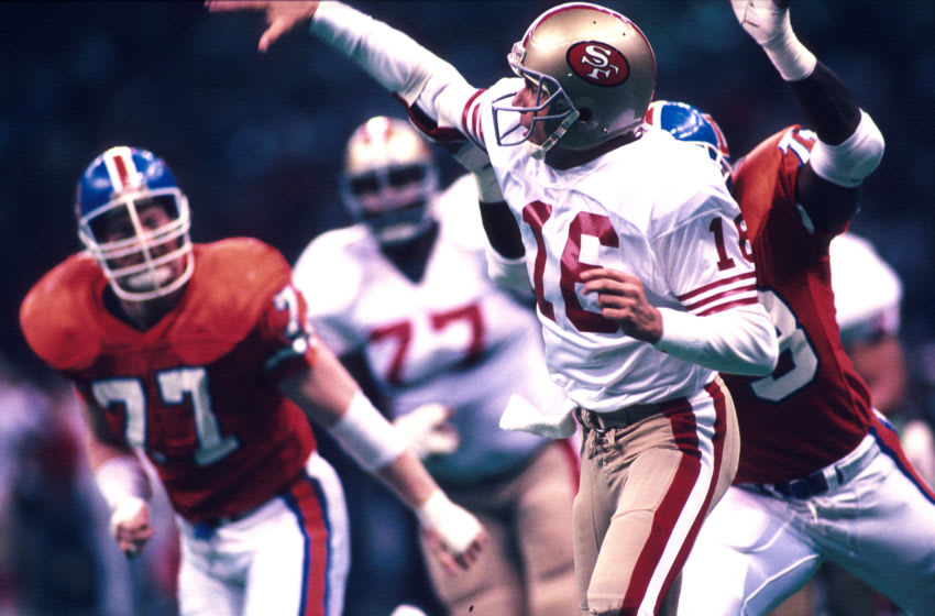 28 Jan 1990: Quarterback Joe Montana of the San Francisco 49ers throws while pressured during the 49ers 55-10 victory over the Denver Broncos in Super Bowl XXIV at the Louisiana Superdome in New Orleans, LA. (Photo by Icon Sportswire)