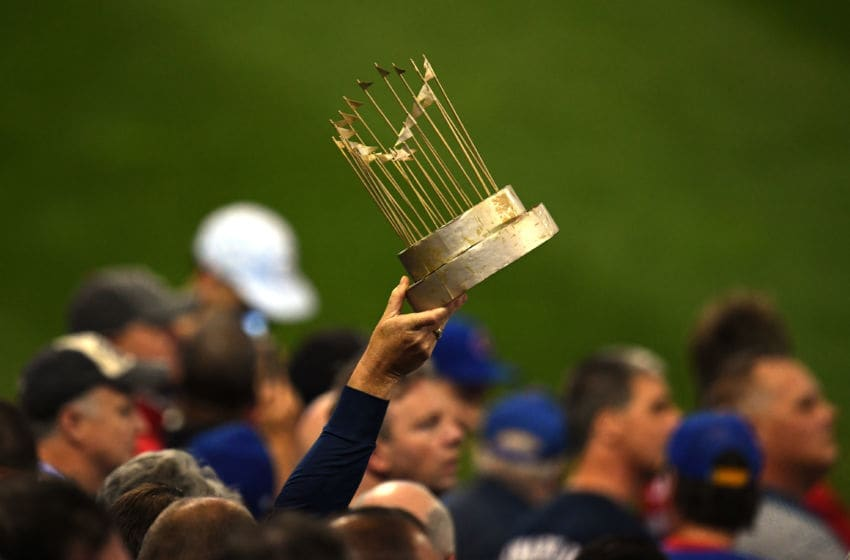 CLEVELAND, OH - NOVEMBER 02: A fan holds up a mock trophy during Game Seven of the 2016 World Series between the Chicago Cubs and the Cleveland Indians at Progressive Field on November 2, 2016 in Cleveland, Ohio. (Photo by Jason Miller/Getty Images)