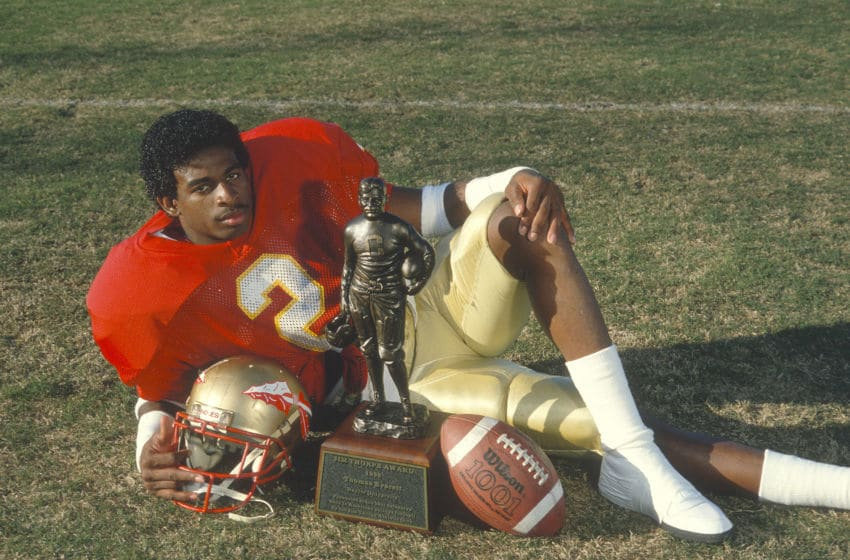 TALLAHASSEE, FL - CIRCA 1988: Defensive back Deion Sanders #2 of the Florida State Seminoles winner of the 1988 Jim Thorpe Award, poses with the trophy circa 1988 at Doak Campbell Stadium at Florida State University in Tallahassee, Florida. (Photo by Focus on Sport/Getty Images)