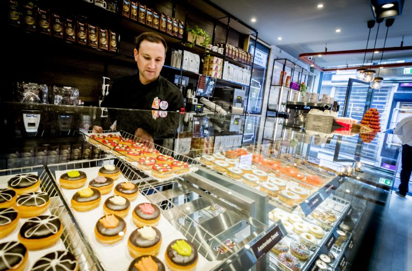 Donut brand Dunkin' Donuts prepares for the opening of the first store in Amsterdam, on March 22, 2017. The Dunkin' Donuts store will open on March 23rd, seventeen years after the last brandstore closed in the Netherlands. / AFP PHOTO / www.anpfoto.nl AND ANP / Remko de Waal / Netherlands OUT (Photo credit should read REMKO DE WAAL/AFP/Getty Images)