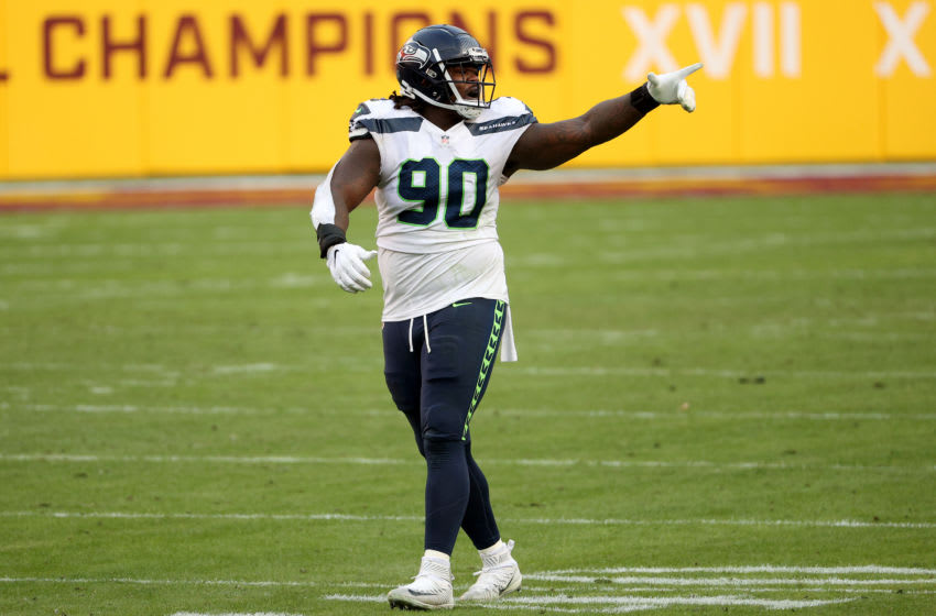 LANDOVER, MARYLAND - DECEMBER 20: Defensive tackle Jarran Reed #90 of the Seattle Seahawks celebrates a sack against the Washington Football Team in the second half at FedExField on December 20, 2020 in Landover, Maryland. (Photo by Patrick Smith/Getty Images)
