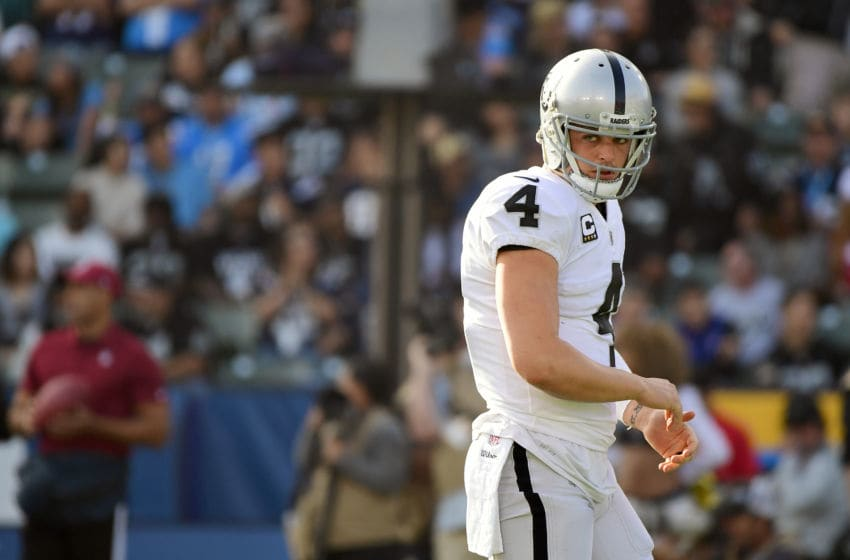 CARSON, CA - DECEMBER 31: Derek Carr #4 of the Oakland Raiders reacts after an offensive penalty during the second quarter of the game against the Los Angeles Chargers at StubHub Center on December 31, 2017 in Carson, California. (Photo by Harry How/Getty Images)