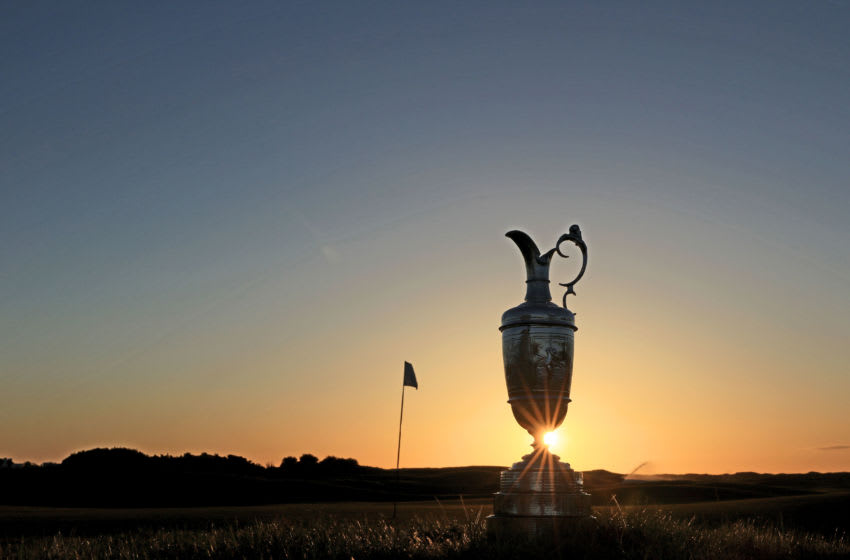 CARNOUSTIE, SCOTLAND - APRIL 24: EDITORS NOTE GRADUATED COLOUR FILTER USED ON THE CAMERA; The Claret Jug, the Open Championship trophy as the sun rises beside the sixth green during the media day for the 147th Open Championship on the Championship Course at the Carnoustie Golf Links on April 24, 2018 in Carnoustie, Scotland. (Photo by David Cannon/R&A/R&A via Getty Images)
