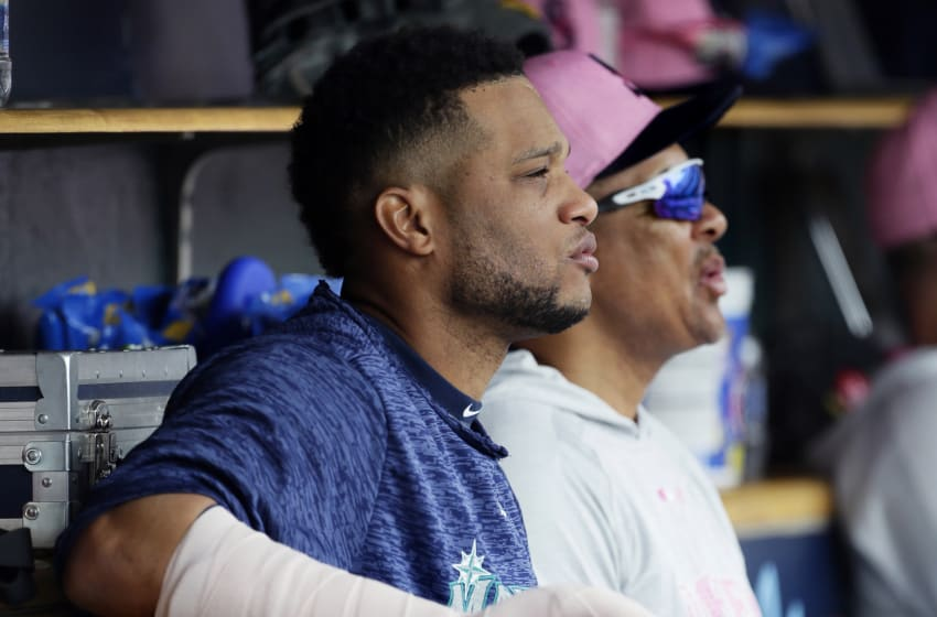 DETROIT, MI - MAY 13: Robinson Cano #22 of the Seattle Mariners sits on the bench with his right hand in a cast after getting hit on the hand and leaving the game against the Detroit Tigers during the third inning at Comerica Park on May 13, 2018 in Detroit, Michigan. (Photo by Duane Burleson/Getty Images)