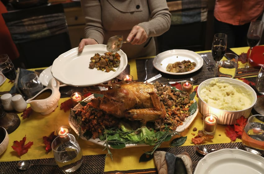 STAMFORD, CT - NOVEMBER 24: A Guatemalan immigrant serves stuffing from the Thanksgiving turkey on November 24, 2016 in Stamford, Connecticut. Family and friends, some of them U.S. citizens, others on work visas and some undocumented immigrants came together in an apartment to celebrate the American holiday with turkey and Latin American dishes. They expressed concern with the results of the U.S. Presidential election of president-elect Donald Trump, some saying their U.S.-born children fear the possibilty their parents will be deported after Trump's inauguration. (Photo by John Moore/Getty Images)