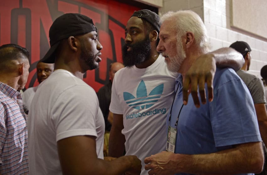 LAS VEGAS, NV - JULY 8: Chris Paul #3, James Harden #13 of the Houston Rockets and Gregg Popovich coach of the San Antonio Spurs talk when the Houston Rockets played the Cleveland Cavaliers during the 2017 Las Vegas Summer League on July 8, 2017 at the Cox Pavilion in Las Vegas, Nevada. NOTE TO USER: User expressly acknowledges and agrees that, by downloading and or using this Photograph, user is consenting to the terms and conditions of the Getty Images License Agreement. Mandatory Copyright Notice: Copyright 2017 NBAE (Photo by David Dow/NBAE via Getty Images)