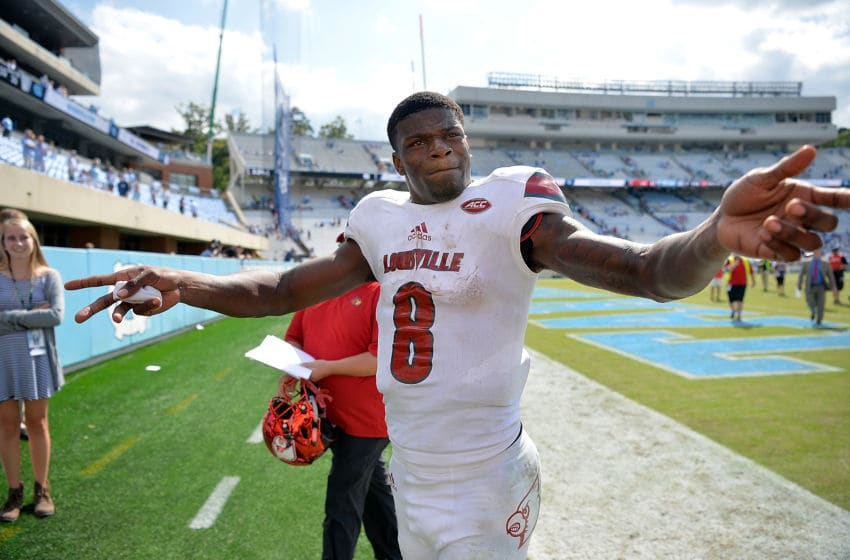 CHAPEL HILL, NC - SEPTEMBER 09: Lamar Jackson #8 of the Louisville Cardinals reacts to the fans as he leaves the field after a win against the North Carolina Tar Heels during the game at Kenan Stadium on September 9, 2017 in Chapel Hill, North Carolina. Louisville won 47-35. (Photo by Grant Halverson/Getty Images)
