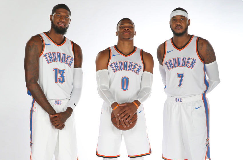 OKLAHOMA CITY, OK - SEPTEMBER 25: Paul George #13, Russell Westbrook #0 and Carmelo Anthony #7 of the Oklahoma City Thunder pose for a portrait during the 2017 NBA Media Day on September 25, 2017 at the Chesapeake Energy Arena in Oklahoma City, Oklahoma. NOTE TO USER: User expressly acknowledges and agrees that, by downloading and or using this Photograph, user is consenting to the terms and conditions of the Getty Images License Agreement. Mandatory Copyright Notice: Copyright 2017 NBAE (Photo by Layne Murdoch/NBAE via Getty Images)