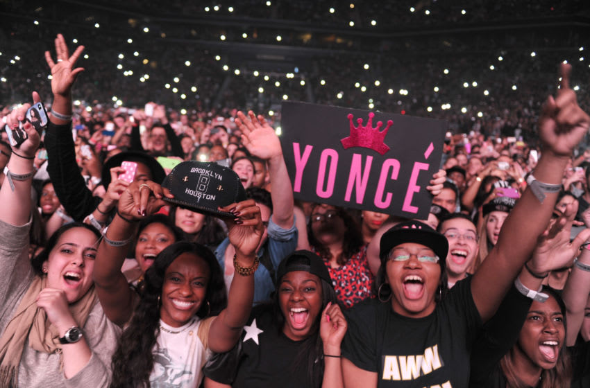 NEW YORK, NY - DECEMBER 22: Fans watch Entertainer Beyonce perform on stage during 'The Mrs. Carter Show World Tour' at the Barclays Center on December 22, 2013 in New York, New York. (Photo by Kevin Mazur/WireImage for Parkwood Entertainment)