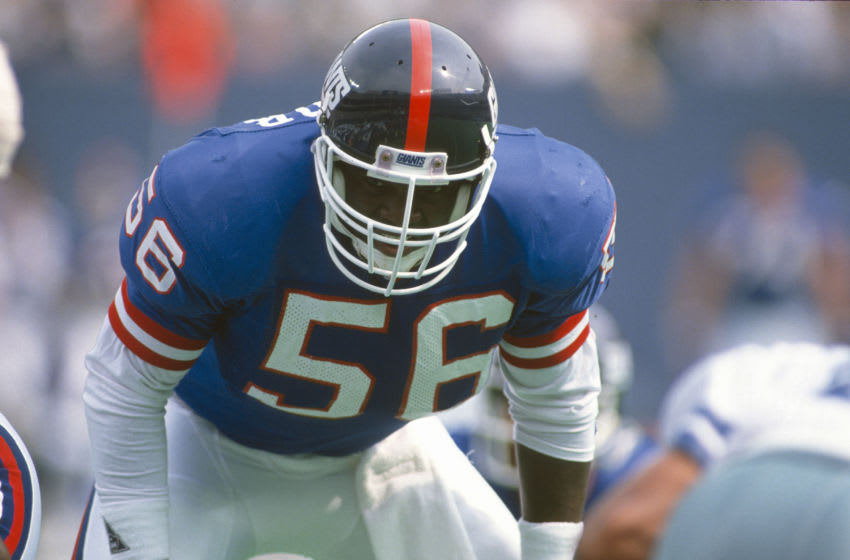 EAST RUTHERFORD, NJ - SEPTEMBER 30: Lawrence Taylor #56 of the New York Giants in action against the Dallas Cowboys during an NFL football game September 30, 1990 at The Meadowlands in East Rutherford, New Jersey. Taylor played for the Giants from 1981-93. (Photo by Focus on Sport/Getty Images)