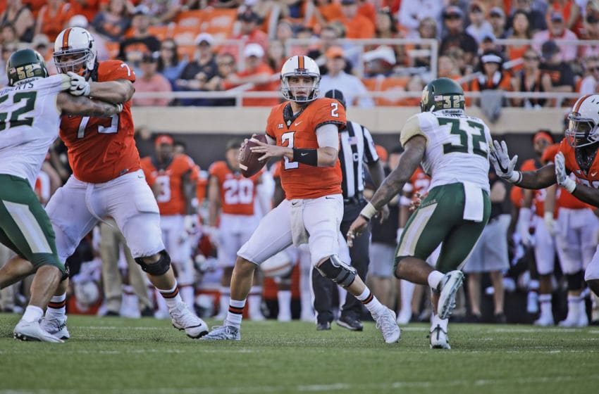 STILLWATER, OK - OCTOBER 14: Quarterback Mason Rudolph #2 of the Oklahoma State Cowboys looks to throw under pressure against the Baylor Bears at Boone Pickens Stadium on October 14, 2017 in Stillwater, Oklahoma. Oklahoma State defeated Baylor 59-16. (Photo by Brett Deering/Getty Images)