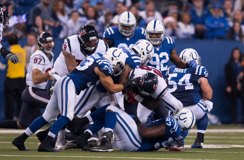 INDIANAPOLIS, IN - DECEMBER 11: Indianapolis Colts inside linebacker Edwin Jackson (53) tackles Houston Texans running back Alfred Blue (28) during the NFL game between the Houston Texans and Indianapolis Colts on December 11, 2016, at Lucas Oil Stadium in Indianapolis, IN. (Photo by Zach Bolinger/Icon Sportswire via Getty Images)
