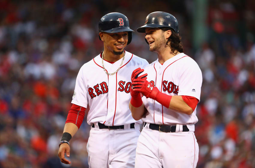 BOSTON, MA - OCTOBER 08: Mookie Betts #50 and Andrew Benintendi #16 of the Boston Red Sox talk during game three of the American League Division Series between the Houston Astros and the Boston Red Sox at Fenway Park on October 8, 2017 in Boston, Massachusetts. (Photo by Maddie Meyer/Getty Images)