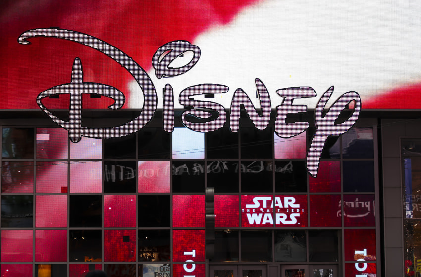NEW YORK, NY - DECEMBER 14: The Disney logo is displayed outside the Disney Store in Times Square, December 14, 2017 in New York City. The Walt Disney Company announced on Thursday morning that it had reached a deal to purchase most of the assets of 21st Century Fox. The deal has a total value of around $66 billion, with Disney assuming $13.7 billion of Fox's net debt. (Photo by Drew Angerer/Getty Images)