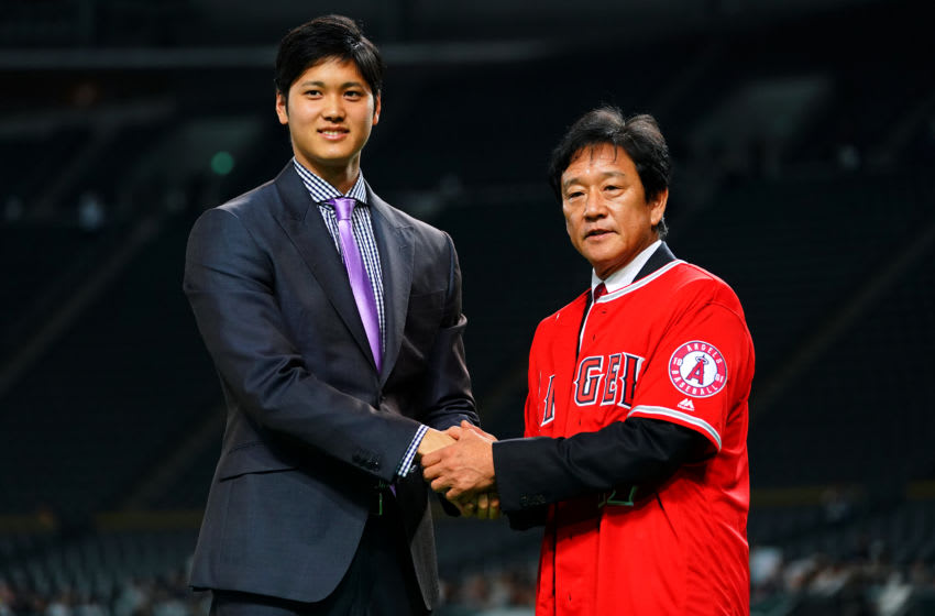 SAPPORO, JAPAN - DECEMBER 25: Shohei Ohtani of the Los Angeles Angels attends his farewell event with Hokkaido Nippon Ham Fighters head coach Hideki Kuriyama at Sapporo Dome on December 25, 2017 in Sapporo, Hokkaido, Japan. (Photo by Masterpress/Getty Images)