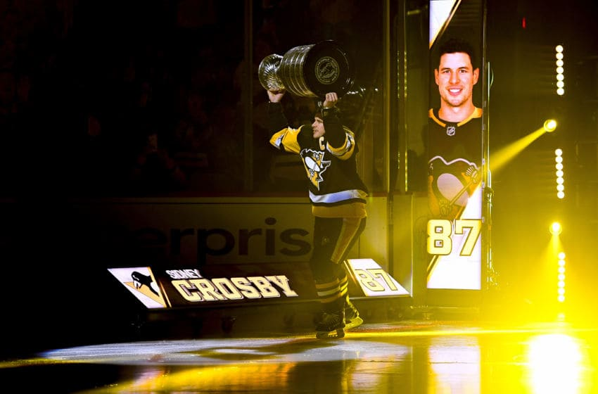 PITTSBURGH, PA - OCTOBER 04: Pittsburgh Penguins center Sidney Crosby (87) hoists the Stanley Cup before the NHL game between the Pittsburgh Penguins and the St. Louis Blues on October 4, 2017, at PPG Paints Arena in Pittsburgh, PA. (Photo by Jeanine Leech/Icon Sportswire via Getty Images)