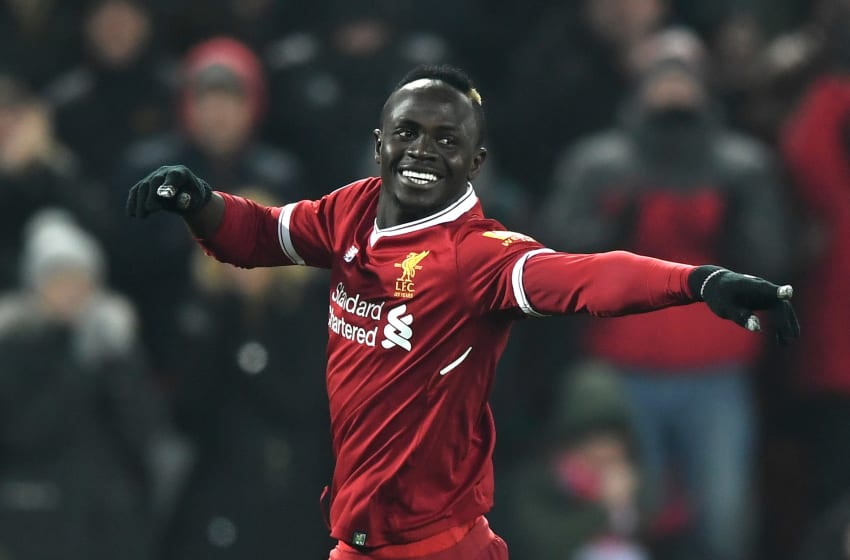 LIVERPOOL, ENGLAND - MARCH 03: Sadio Mane of Liverpool celebrates after scoring his sides second goal during the Premier League match between Liverpool and Newcastle United at Anfield on March 3, 2018 in Liverpool, England. (Photo by Gareth Copley/Getty Images)