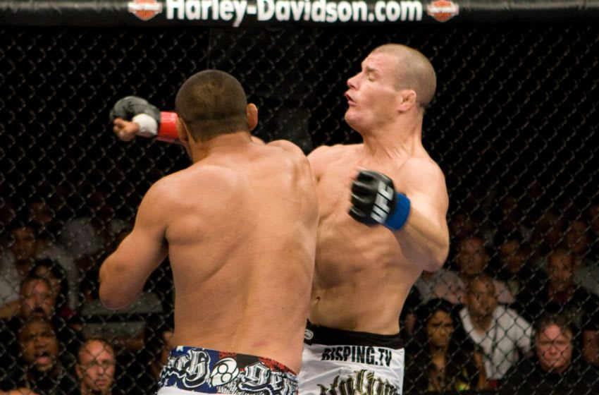 LAS VEGAS - JULY 11: Dan Henderson (white shorts) def. Michael Bisping (black/white shorts) - KO - 3:20 round 2 during UFC 100 at Mandalay Bay Events Center on July 11, 2009 in Las Vegas, Nevada. (Photo by Josh Hedges/Zuffa LLC via Getty Images)