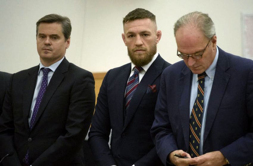 Mixed Martial Artist Conor McGregor (C) pleads guilty to disorderly conduct during a hearing at New York State Supreme Court in Brooklyn, on July 26, 2018. Others are unidentified. - McGregor had been charged with multiple counts of assault and criminal mischief after attacking a bus filled with UFC fighters at the Barclays Center. He pleaded guilty to a lesser charge of disorderly conduct in a fleeting court appearance, and was handed a punishment of five days' community service. (Photo by Charles Eckert / POOL / AFP) (Photo credit should read CHARLES ECKERT/AFP/Getty Images)