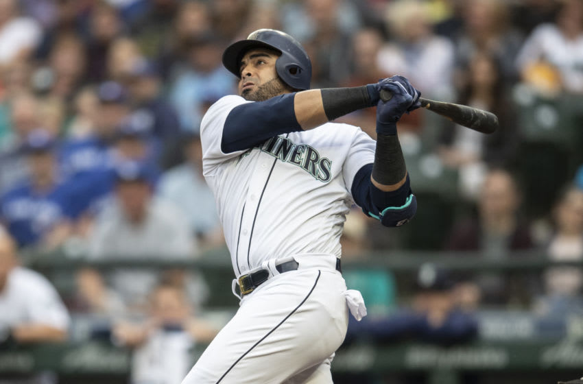 SEATTLE, WA - AUGUST 2: Nelson Cruz #23 of the Seattle Mariners hits a two-run home run off of starting pitcher Tyler Clippard #36 of the Toronto Blue Jays that also scored Dee Gordon #9 of the Seattle Mariners during the first inning of a game at Safeco Field on August 2, 2018 in Seattle, Washington. (Photo by Stephen Brashear/Getty Images)