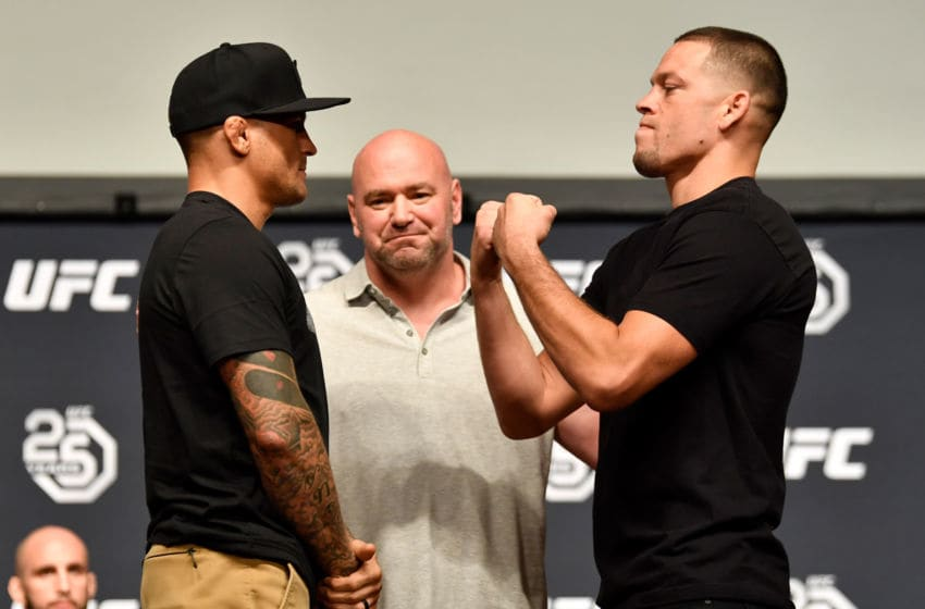 LOS ANGELES, CA - AUGUST 03: (L-R) Opponents Dustin Poirier and Nate Diaz face off during the UFC press conference inside the Orpheum Theater on August 3, 2018 in Los Angeles, California. (Photo by Jeff Bottari/Zuffa LLC/Zuffa LLC via Getty Images)