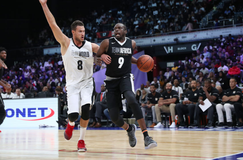 PRETORIA, SOUTH AFRICA - AUGUST 4: Loul Deng #9 of Team Africa handles the ball against Team World during the 2018 NBA Africa Game as part of the Basketball Without Borders Africa on August 4, 2018 at the Time Square Sun Arena in Pretoria, South Africa. NOTE TO USER: User expressly acknowledges and agrees that, by downloading and or using this photograph, User is consenting to the terms and conditions of the Getty Images License Agreement. Mandatory Copyright Notice: Copyright 2017 NBAE (Photo by Joe Murphy/NBAE via Getty Images)